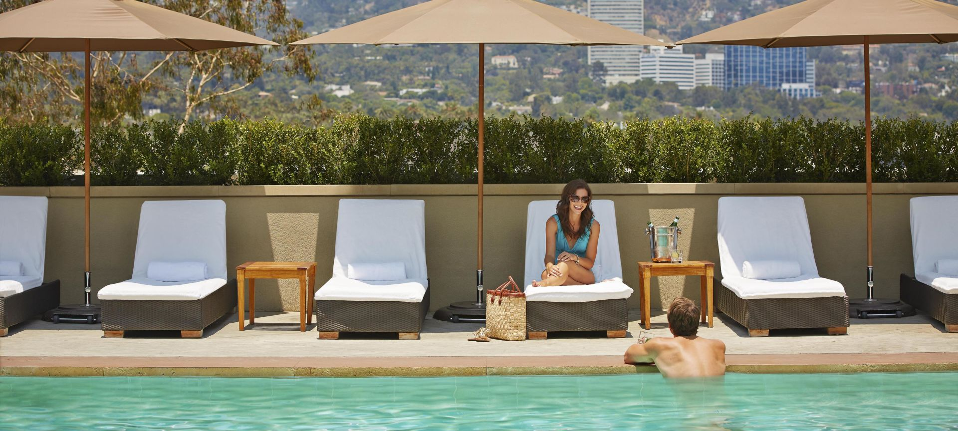 Guests enjoying the pool at Viceroy L'Ermitage Beverly Hills